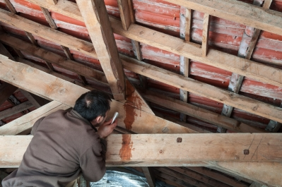 Man repairing roof leaks